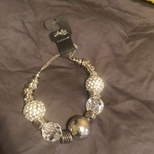 Selling a silver covered diamond inspired necklace
